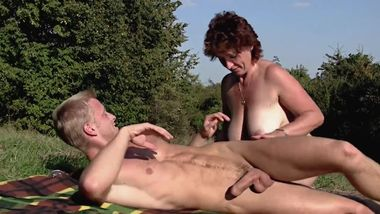 BBW milf outdoors with young boy