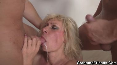 Blonde granny takes double penetration
