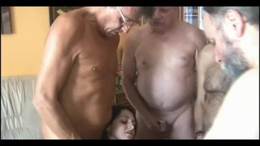 Bellied old men share a shaved youngster