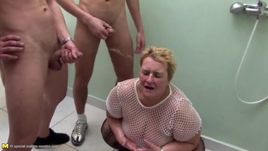 Big granny at crazy pee gangbang with young boys