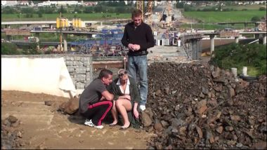 Young cute blonde teen girl PUBLIC threesome at a constructi